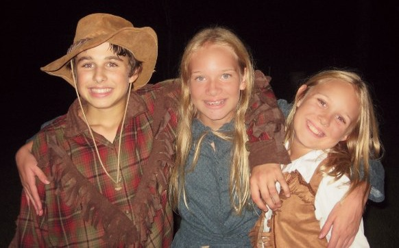 (L-R) Cousin Luke, me, sister Mackenzie pose in our pioneer get-up.